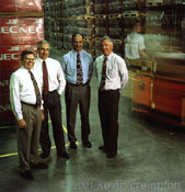 Executives in a warehouse